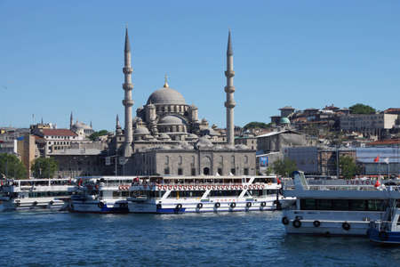 camii: ISTANBUL - MAY 18, 2014 - Bosphorus ferry carries tourists and commuters across the Golden Horn, with the Yeni Camii mosque in background,  in Istanbul, Turkey Editorial