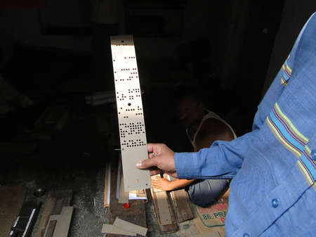 punched: Jacquard loom is a mechanical loom that uses punched cards to program the pattern for weaving Stock Photo