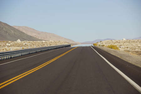 a mirage: Mirage on otherwise deserted highway in  Nevada Stock Photo
