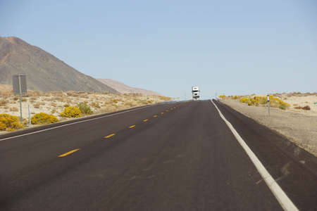 nevada: Mirage on otherwise deserted highway in  Nevada Stock Photo