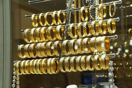 finery: Gold bracelets and bangles  in goldsmith shops of the  Bazaar in  Bursa, Turkey