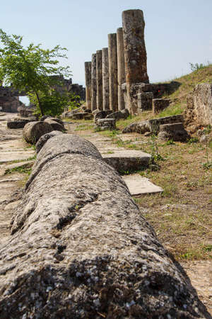 toppled: Toppled columns line the  ruins of collonaded street near the  Hierapolis, Turkey