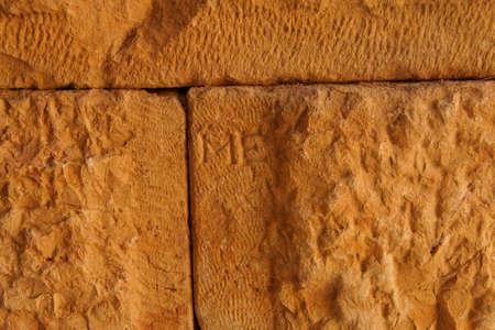 initials: Stone masons initials still seen on Rough cut stones for the Roman theatre  of Myra,  Turkey