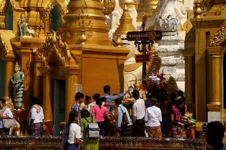 planetary: YANGON, BURMA - FEB 18, 2015 - Offering of holy water at planetary post, name day, shrine, Shwedagon Pagoda Yangon (Rangoon),  Myanmar (Burma) Editorial