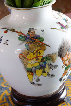 Chinese mounted warrior, painting on vase in Fukian Assembly Hall,  Hoi An, Vietnam