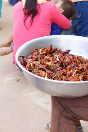 Spicy, roasted baby chicks, with heads, a traditional snack, Skoun,  Cambodia Stock fotó - 37425775