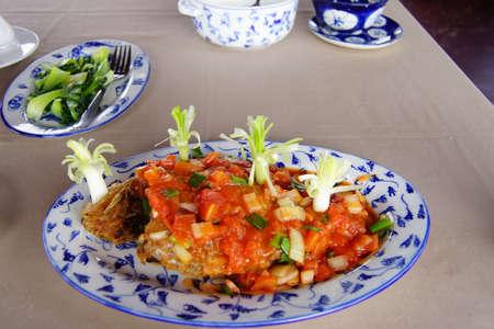 Ca dieu huong sot ca, stir fried whole fish with tomato sauce,  Vietnam