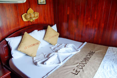 stateroom: MEKONG RIVER, VIETNAM - FEB 6, 2015 - Bed in stateroom of Le Cochinchine,  Mekong River delta,  Vietnam