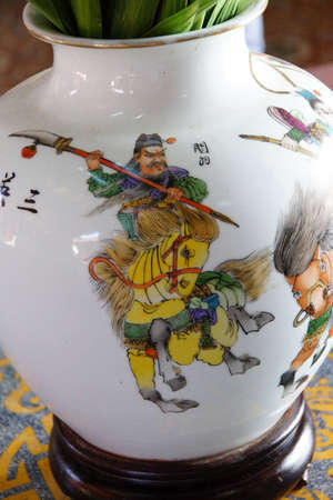 assembly hall: Chinese mounted warrior, painting on vase in Fukian Assembly Hall,  Hoi An, Vietnam