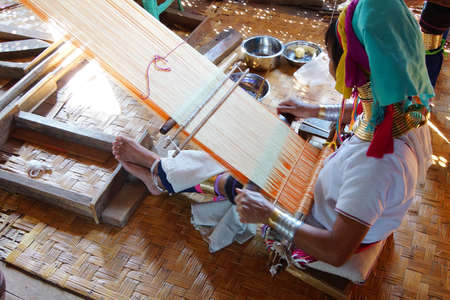 necked: Long necked Kayan Padaung woman weaving on a loom,  Inle Lake,  Myanmar (Burma) Stock Photo