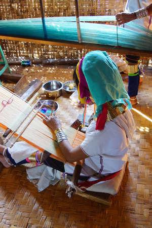 long lake: Long necked Kayan Padaung woman weaving on a loom,  Inle Lake,  Myanmar (Burma) Stock Photo