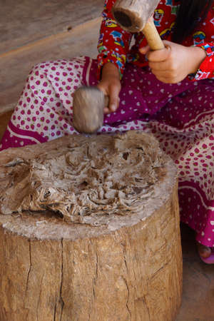 Pounding mulberry pulp to make paper, near Inle Lake Myanmar (Burma)