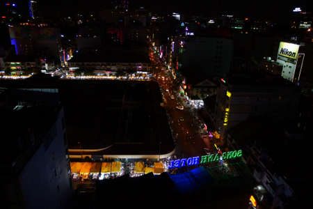 SAIGON - FEB 5, 2015 - Aerial view of central Saigon at night - neon and traffic lights, Saigon (Ho Chi Minh City). Vietnam