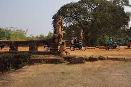 thom: KAMPONG THOM, CAMBODIA - FEB 12, 2015 - Naga serpent on ancient 8th century Angkor bridge,  near Kampong Thom,  Cambodia