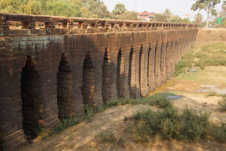 sturdy: Sturdy corbeled arches of ancient 8th century Angkor bridge,  near Kampong Thom,  Cambodia