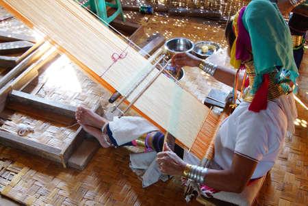 long lake: Long necked Kayan Padaung woman weaving on a loom,  Inle Lake,  Myanmar (Burma) Editorial