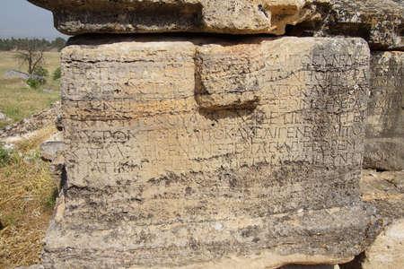 greek alphabet: Greek inscription on sarcophagus tomb in the necropolis of  Hierapolis,  Turkey Stock Photo