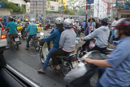 SAIGON - FEB 4, 2015 - Blur of motorbike traffic in rush hour, Saigon (Ho Chi Minh City),  Vietnam