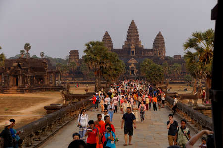 ANGKOR WAT, CAMBODIA - FEB 13, 2015 - Tourists going to watch the sunset at Angkor Wat,  Cambodia