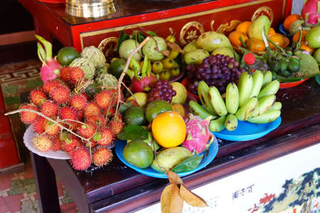 assembly hall: HOI AN, VIETNAM - FEB 3 - 2015 - Offerings of fruit at the altar of a fertility deity,  Fukian Assembly Hall, Hoi An, Vietnam
