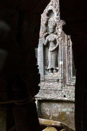 Serene apsaras adorn the walls of the ancient temple of Ta Prohm,  Cambodia