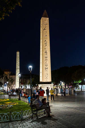hippodrome: ISTANBUL - MAY 18, 2014 - Tourists take an evening stroll past the Egyptian obelisk on the ancient site of the Hippodrome   in Istanbul, Turkey