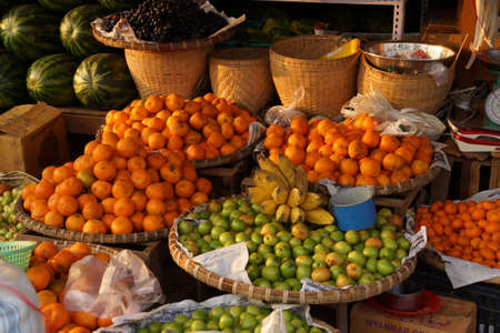 Melons, bananas, oranges and apples for sale  at the street market in Kyaukme Myanmar (Burma) Stock Photo