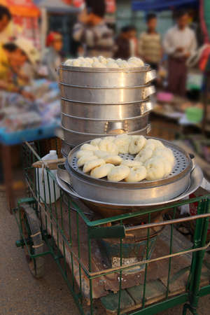 Steamed hombow dim sum ready to eat  at the street market in Kyaukme Myanmar (Burma)