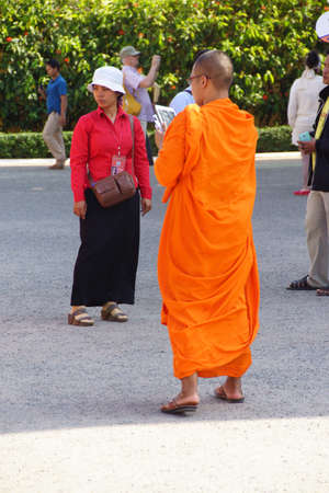 penh: PHNOM PENH, CAMBODIA - FEB 8, 2015 - Young Buddhist monk checking his cellphone,  Phnom Penh,   Cambodia Editorial