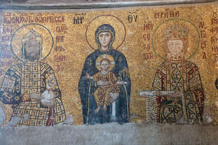 flanked: ISTANBUL - MAY 17, 2014 - Virgin Mary and infant Christ child, flanked by Emperor John Comnenus and Eirene Byzantine mosaic in the gallery of  Hagia Sophia  in Istanbul, Turkey