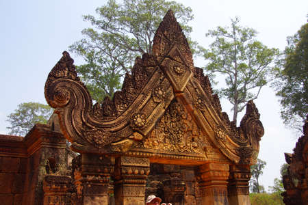 portals: Intricate stone carving on red sandstone doorways and portals,  Banteay Srei, Cambodia