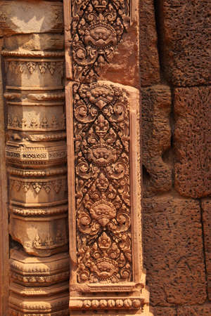 doorways: Intricate stone carving on red sandstone doorways and portals,  Banteay Srei, Cambodia