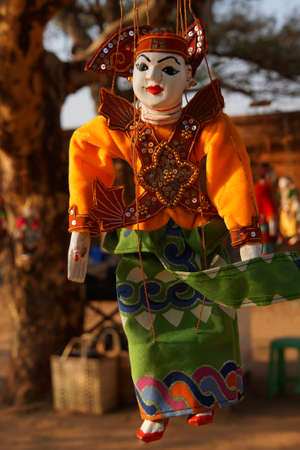 burmese: Traditional Burmese puppets hanging on display outside the Dhammayangyi Temple, Bagan Myanmar (Burma)
