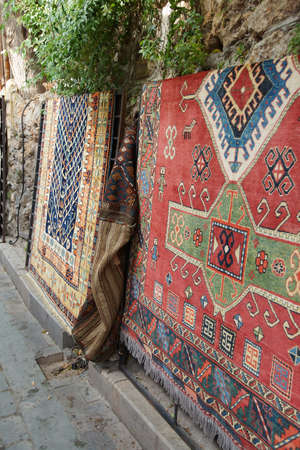 oriental rug: Carpet shops display their wares on street climbing up from the harbor,  Antalya,  Turkey