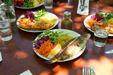 Fresh trout and kebabs and salad for lunch  at a restaurant  near Saklikent gorge,  Turkey Фото со стока - 39695096
