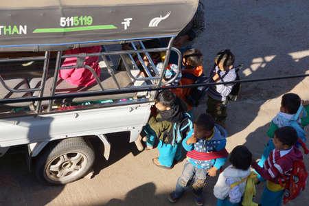 local 27: KALAW, BURMA - FEB 27, 2015 - Young children line up for the local school bus,  Kalaw,  Myanmar (Burma)