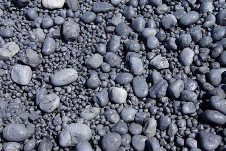 cobbles: Cobbles, smooth and rounded, form patterns on the beach, Cobble Beach, Yaquina Head,  Oregon Coast Stock Photo