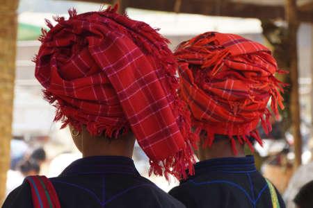 INLE LAKE, MYANMAR - MAR 1, 2015 - Woman wearing traditional Shan red headdress, at the weekly market near  Inle Lake,  Myanmar (Burma) Фото со стока