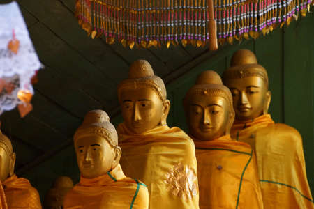 topknot: Row of statues of Buddhist monks with topknots,  100 years old Shan monastery, near Hsipaw, Myanmar (Burma) Stock Photo