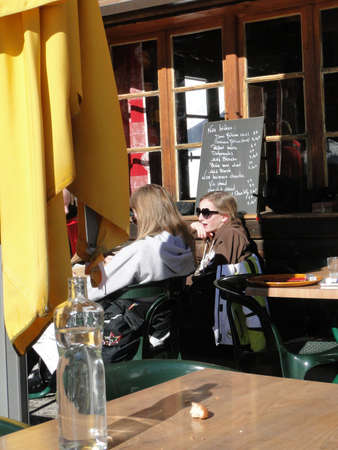 skiers: AVORIAZ, FRANCE - FEB 21 - Skiers enjoy lunch outdoors in the sun  on Feb 21, 2012 in Avoriaz, France Editorial