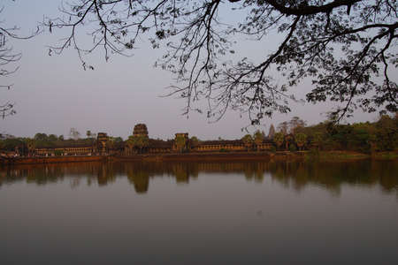 moat wall: Sunset, tourists on the causeway across the moat of Angkor Wat,  Cambodia