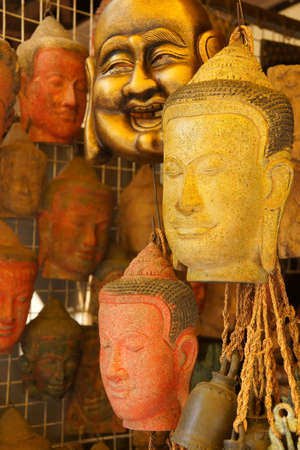 Buddha head masks and carvings,  Old Market, Siem Reap,  Cambodia