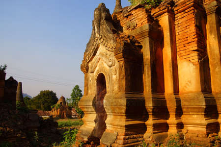buddhist stupa: Ornate and elaborately carved doorway of  ancient Buddhist stupa at In Dein on  Inle Lake,  Myanmar (Burma)