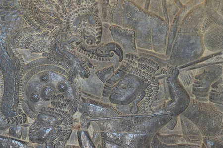 bas: Detail of battle of devas and asuras,  bas relief  North Gallery, west wing Angkor Wat,  Cambodia Stock Photo