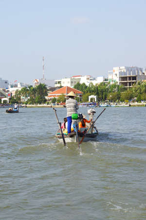 cai: Woman ferries passengers across the Mekong River,  Cai Rang,  Vietnam Stock Photo