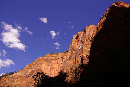define: Shadows define the steep cliff faces of Mount SinewavaZion National Park, Utah Stock Photo