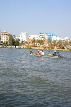 cai rang: Woman ferries passengers across the Mekong River,  Cai Rang,  Vietnam Stock Photo