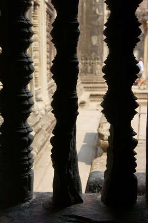 balustrades: Stone balustrades give views of the interior galleries of  Angkor Wat,  Cambodia