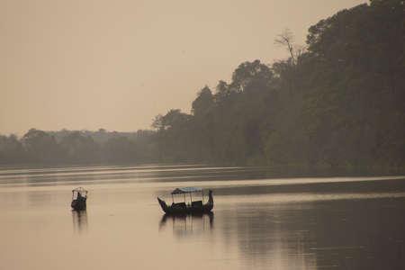 Traditional boats on the moat at dusk, Angkor Wat, Cambodia