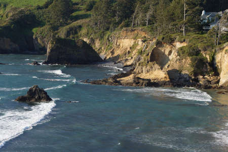 hillsides: Beach and surf near rocky coast hillsides,  Oregon Coast Stock Photo